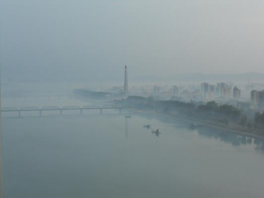 Pyongyang at dawn. Not a Photoshop. That's the Tower of the Juche Idea in the morning mist