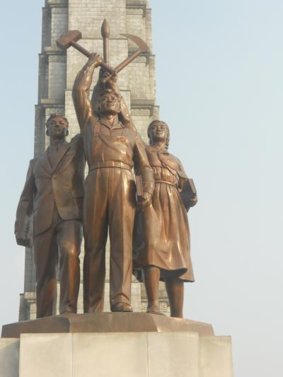 "The statue in front of the Tower, ""inspired"" by the Soviet ""Worker and Kolkhoz Woman""."